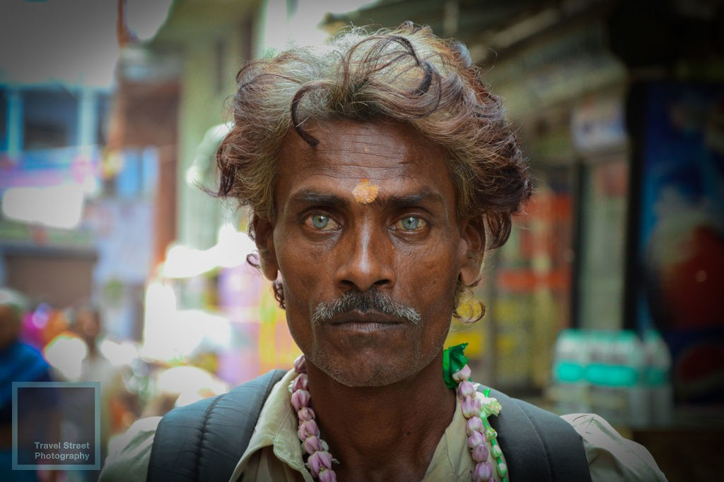 travel street photography hindu pilgrim blue eyes varanasi benares india people portrait