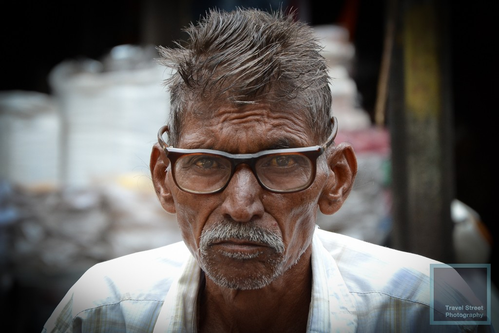 travel street photography indian man with glasses udaipur india people portrait