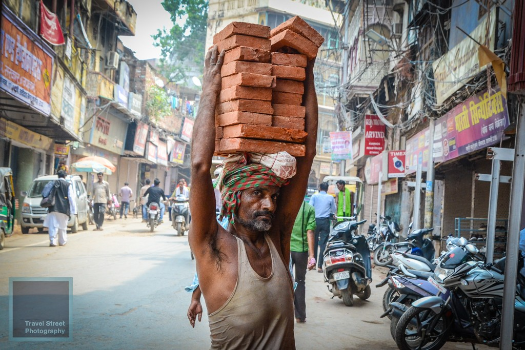 travel street photography construction worker carrying bricks varanasi benares india people