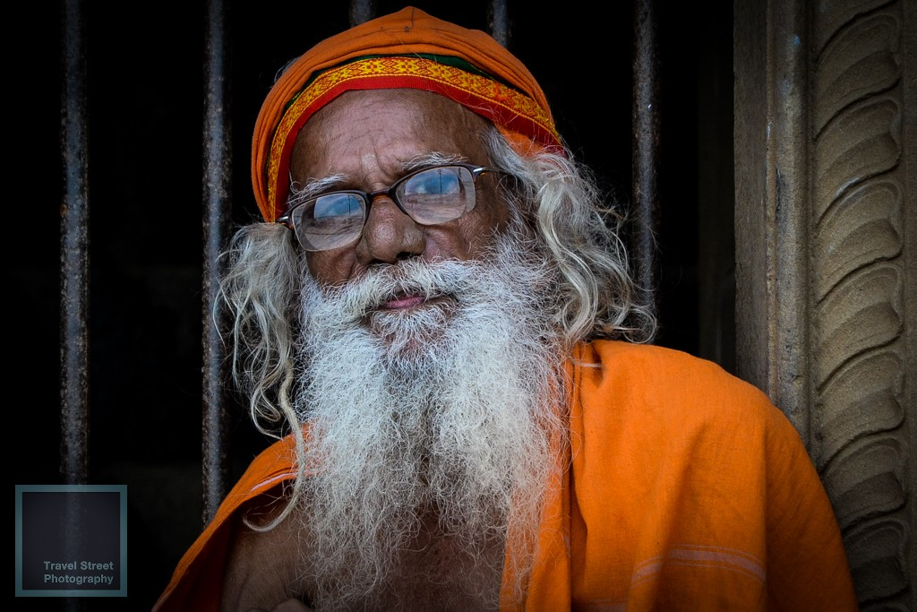 travel street photography sadhu with glasses varanasi benares india people portrait