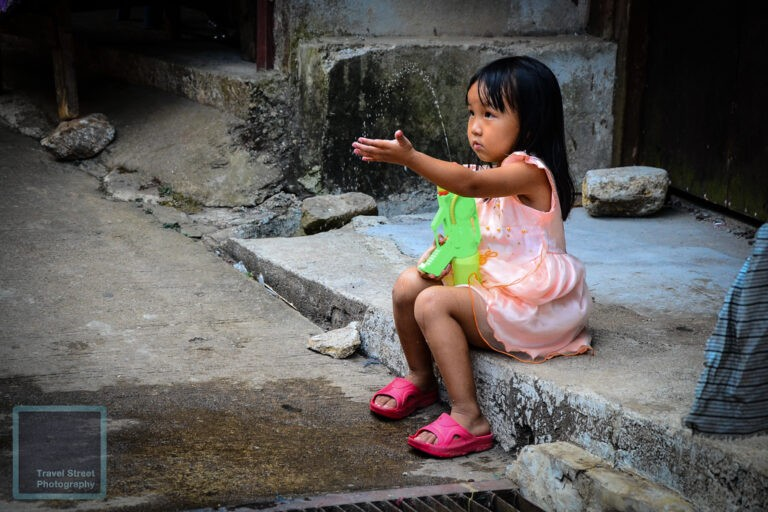 travel street photography little girl with water gun chiang mai thailand people
